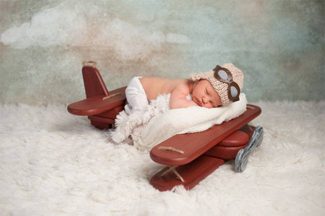 Baby sleeping on a small airplane