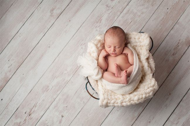 Baby in a Basket and Wood Floor